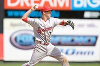 Spokane Indians' Nick Urbanus #7 throws to first base during a game against the Everett AquaSox at Everett Memorial Stadium on June 24, 2012 in Everett, WA.  Spokane defeated Everett 11-2.  (Ronnie Allen/Four Seam Images)