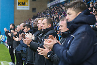 The management teams of both sides during a minutes applause for Jimmy Armfield ahead of the Sky Bet League 1 match between Gillingham and Fleetwood Town at the MEMS Priestfield Stadium, Gillingham, England on 27 January 2018. Photo by David Horn.