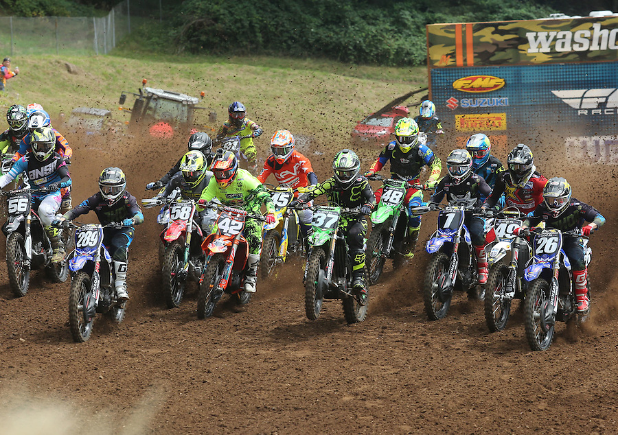 A cluster of motorcycles are seen at the start of the 250 cc race in the Washougal MX National in Washougal Saturday July 23, 2016. D(Photo by Natalie Behring/ for the The Columbian)