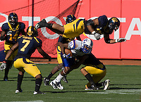September 17, 2011:  California's Ted Agu dives over to avoid late hit during a game against Presbyterian at AT&T Park, San Francisco, Ca California Defeated Presbyterian 63 - 12
