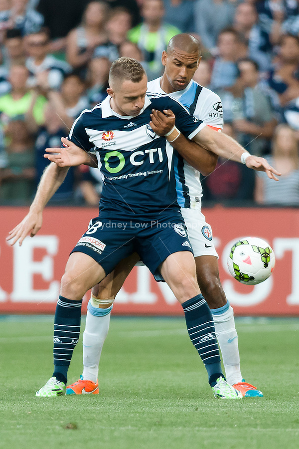 Besart BERISHA of the Victory and Patrick KISNORBO of Melbourne City fight for the ball in round 11 A-League match between Melbourne City and Melbourne Victory at AAMI Park in Melbourne, Australia during the 2014/2015 Australian A-League season. City def Victory 1-0