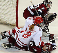 Badger freshman forward Emily Kranz fights in front of the net in a defensive battle at the Kohl Center Saturday
