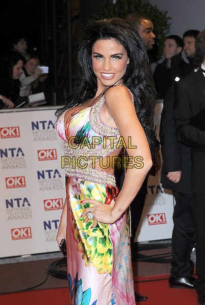 JORDAN - KATIE PRICE.Arrivals at the 15th National Television Awards held at the O2 Arena, London, England. .January 20th, 2010 .NTA NTAs half length white pink blue green orange cleavage dress beaded diamante jewel encrusted multi-coloured hand on hip side .CAP/BEL.©Tom Belcher/Capital Pictures