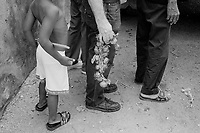 Farmers sell garlic on the street for pesosn in Havana, Cuba, August, 2001. Facing difficulties from the loss of Soviet support, Cuba opened an unofficial dollar economy in the late 1990s.