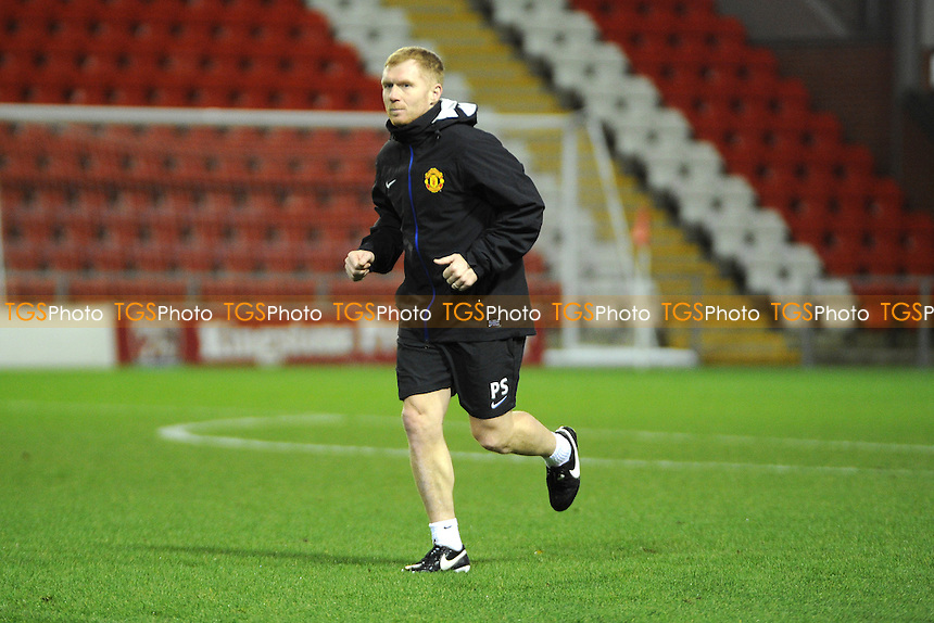 Former United player Paul Scholes warms up ahead of the warmup - Manchester United Under-19 vs Shaktar Donetsk Under-19- UEFA Youth League Football at Leigh Sports Village - 09/12/13 - MANDATORY CREDIT: Greig Bertram/TGSPHOTO - Self billing applies where appropriate - 0845 094 6026 - contact@tgsphoto.co.uk - NO UNPAID USE