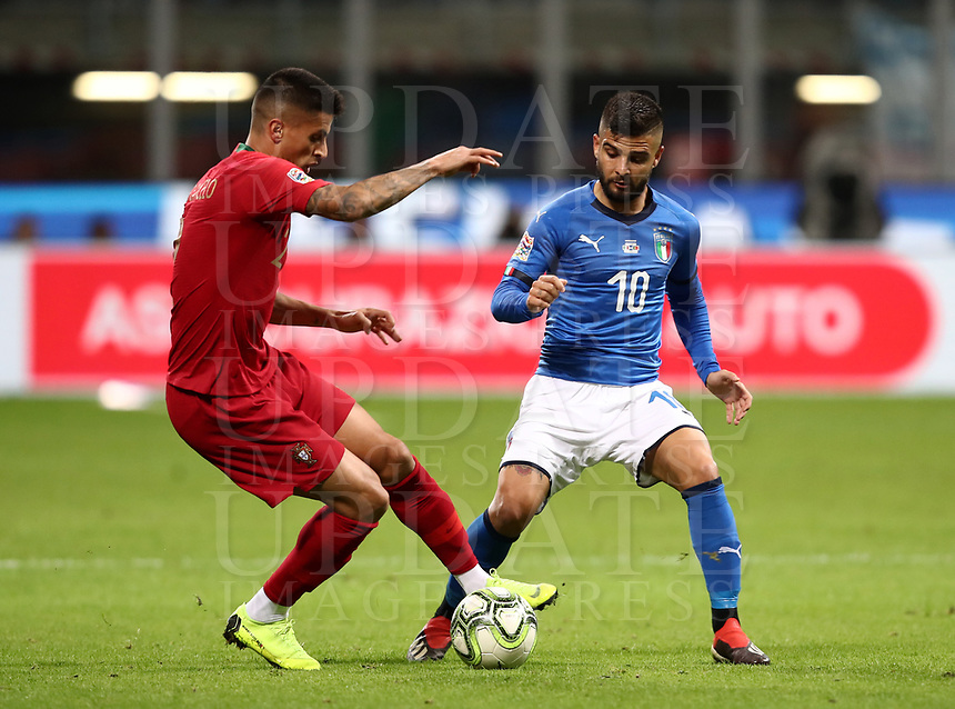 Football: Uefa Nations League Group 3match Italy vs Portugal at Giuseppe Meazza (San Siro) stadium in Milan, on November 17, 2018.<br /> Portugal's Joao Cancelo (l) in action with Italy's Lorenzo Insigne (r) during the Uefa Nations League match between Italy and Portugal at Giuseppe Meazza (San Siro) stadium in Milan, on November 17, 2018.<br /> UPDATE IMAGES PRESS/Isabella Bonotto<br /> <br /> UPDATE IMAGES PRESS/Isabella Bonotto