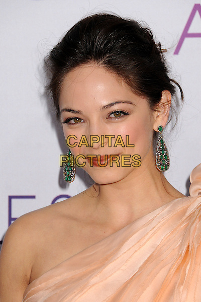 Kristin Kreuk.People's Choice Awards 2013 - Arrivals held at Nokia Theatre L.A. Live, Los Angeles, California, USA..January 9th, 2013.headshot portrait dangling earrings green peach one shoulder top gold .CAP/ADM/BP.©Byron Purvis/AdMedia/Capital Pictures.