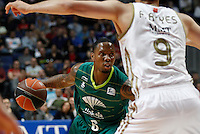 01.04.2012 SPAIN - ACB match played between Real Madrid vs Unicaja  at Palacio de los deportes stadium. The picture show Earl Jerrod Rowland (Unicaja) and  Felipe Reyes Cabanas (Spanish center of Real Madrid)