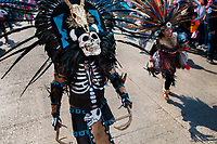 A Mexican man, wearing a scull mask, performs an ancient Aztec Death Worship dance on the street during the Day of the Dead festival in Mexico City, Mexico, 29 October 2016. Day of the Dead (Día de Muertos), a syncretic religious holiday combining the death veneration rituals of the ancient Aztec culture with the Catholic practice, is celebrated throughout all Mexico. Based on the belief that the souls of the departed may come back to this world on that day, people gather at the gravesites in cemeteries praying, drinking and playing music, to joyfully remember friends or family members who have died and to support their souls on the spiritual journey.