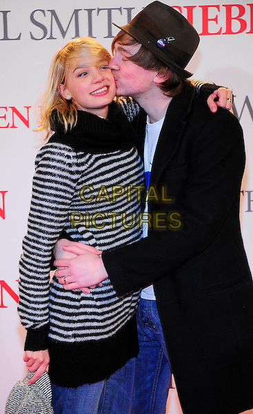 "JYTTE MERLE BOHRNSEN & TINO MEWES.German premiere for ""Seven Pounds"", CineStar Sony Center, Berlin, Germany..January 6th, 2009.half length black jacket hat white striped stripes top hug embrace profile kiss kissing .CAP/PPG/NK.©Norbert Kesten/People Picture/Capital Pictures"