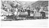 3/4 fireman's-side view of C&amp;S #60 and a coach on display at Idaho Springs.<br /> C&amp;S  Idaho Springs, CO
