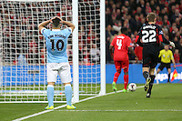 Sergio Aguero of Manchester City holds his head in his hands after missing a chance to score in the first half of extra time during the Capital One Cup match between Liverpool and Manchester City at Wembley Stadium, London, England on 28 February 2016. Photo by David Horn / PRiME Media Images.