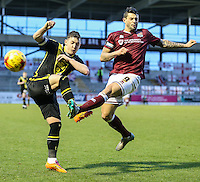 Marc Richards of Northampton Town (right) and Adam Dugdale of Morecambe (left) battle for the ball during the Sky Bet League 2 match between Northampton Town and Morecambe at Sixfields Stadium, Northampton, England on 23 January 2016. Photo by David Horn / PRiME Media Images.