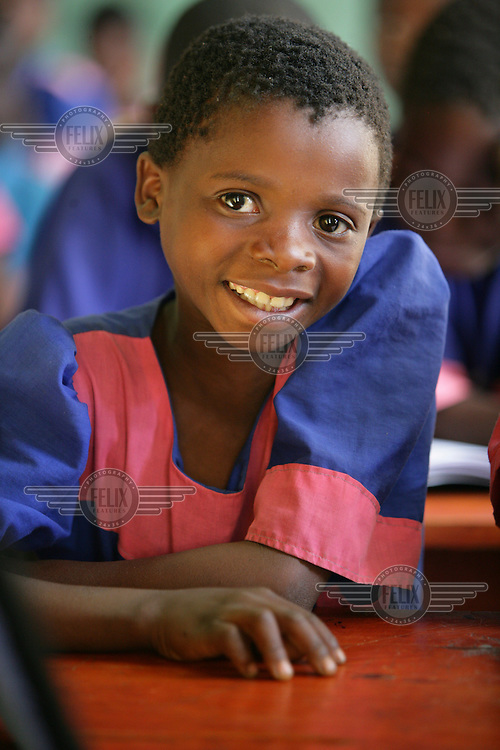 A portrait of a young child in class. Primary education is free of charge in Malawi. However, although many children start school, around 60% drop out before completing their primary schooling.