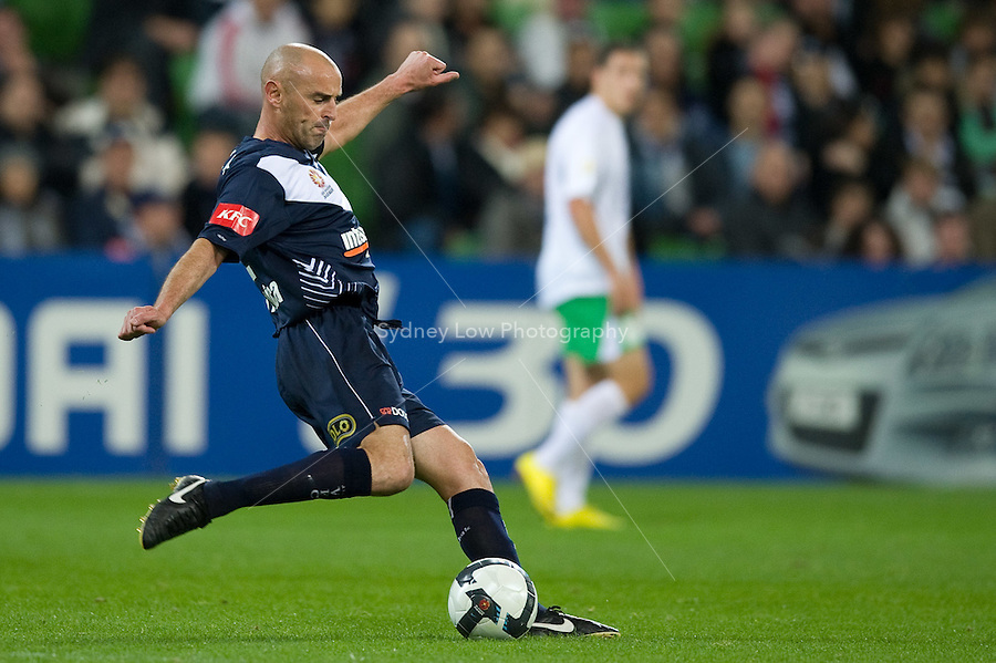 MELBOURNE, AUSTRALIA - May 14, 2010: Kevin Muscat from Melbourne Victory kicks the ball during the Kevin Muscat Testimonial match between the Melbourne Victory and Come Play XI at AAMI Park on May 14, 2010 in Melbourne, Australia. Photo Sydney Low www.syd-low.com