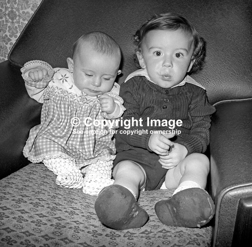 Margaret McDonald, 4 months, and her brother, Seamus, 30 months, who were orphaned 9th July 1976 as a result of the sectarian killing, admitted by the UFF / UDA,  of their parents, Mervyn McDonald, 26 years, and Rosaleen McDonald, 24 years. Their home at Longlands Road, Newtownabbey, N Ireland, was described as a mixed area i.e. where Protestants and Roman Catholics lived side by side. 197607090384a<br />
