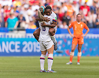 LYON,  - JULY 7: Julie Ertz #8 celebrates with Crystal Dunn #19 during a game between Netherlands and USWNT at Stade de Lyon on July 7, 2019 in Lyon, France.