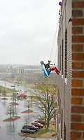 NWA Democrat-Gazette/BEN GOFF @NWABENGOFF<br /> Nicky Dou of Bentonville rappels wearing a Wonder Woman cape Saturday, March 11, 2017, during the Sunshine School &amp; Development Center's rappelling fundraiser with Over The Edge at the 8W Center in Bentonville. The school began a campaign in January, with participants who reached their fundraising goal able to participate in rappelling from the roof of the 6-story building. Over the Edge is a company which specializes in producing events for non profits using equipment and techniques used in commercial rope-access work such as sign installation and window washing. The event had raised more than $57,000 for the school, with more donations still coming in Saturday morning. Located in Rogers, the Sunshine School &amp; Development Center serves children and adults with developmental dissabilities, including a preschool.