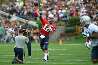 July 24, 2014 - Foxborough, Massachusetts, U.S.- New England Patriots quarterback Tom Brady (12) keeps his eyes on an intended receiver while making a pass during the New England Patriots training camp held at Gillette Stadium in Foxborough Massachusetts. Eric Canha/CSM