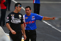 May 19, 2014; Commerce, GA, USA; NHRA pro stock motorcycle rider Hector Arana Jr (right) talks with pro stock driver Vincent Nobile during the Southern Nationals at Atlanta Dragway. Mandatory Credit: Mark J. Rebilas-USA TODAY Sports