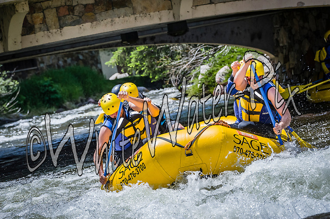 Sage Outdoor Adventures crashing International Bridge Rapid while running Gore Creek from East Vail to Lionshead on the afternoon of June 23, 2015.