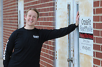 NWA Media/ J.T. Wampler - Syard Evans  works out at CrossFit Fayetteville Dec. 27, 2014.