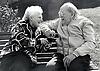 Elderly couple laughing on bench, Nottingham UK 1991