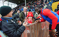 Lincoln City's John Akinde poses for a photograph with a fan during the pre-match warm-up<br /> <br /> Photographer Chris Vaughan/CameraSport<br /> <br /> The Emirates FA Cup Second Round - Lincoln City v Carlisle United - Saturday 1st December 2018 - Sincil Bank - Lincoln<br />  <br /> World Copyright © 2018 CameraSport. All rights reserved. 43 Linden Ave. Countesthorpe. Leicester. England. LE8 5PG - Tel: +44 (0) 116 277 4147 - admin@camerasport.com - www.camerasport.com