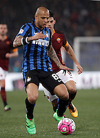 Calcio, Serie A: Roma vs Inter. Roma, stadio Olimpico, 19 marzo 2016.<br /> FC Inter&rsquo;s Felipe Melo, left, is challenged by Roma&rsquo;s Diego Perotti during the Italian Serie A football match between Roma and FC Inter at Rome's Olympic stadium, 19 March 2016. The game ended 1-1.<br /> UPDATE IMAGES PRESS/Isabella Bonotto
