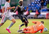 16th July 2020, Orlando, Florida, USA;  Columbus Crew forward Gyasi Zerdes (11) is blocked by the goalkeeper during the MLS Is Back Tournament between the Columbus Crew SC versus New York Red Bulls on July 16, 2020 at the ESPN Wide World of Sports, Orlando FL.