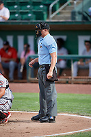 Home plate umpire Trey Thompson makes the calls behind the plate as the Billings Mustangs faced the Ogden Raptors at Lindquist Field on August 13, 2017 in Ogden, Utah. The Raptors defeated the Mustangs 6-5.  (Stephen Smith/Four Seam Images)