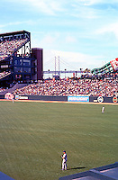 Ballparks: San Francisco Pacific Bell Park. Looking to left from Right Field stands. Eric Owens of Padres in right field. Bay Bridge visible.