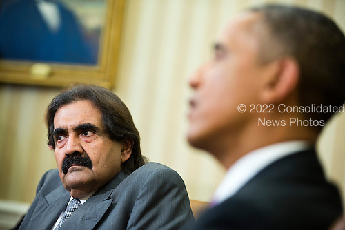 United States President Barack Obama speaks during a meeting with the Amir of Qatar, Hamad bin Khalifa al-Thani, in the Oval Office of the White House on Tuesday, April 23, 2013. <br /> Credit: Joshua Roberts / Pool via CNP