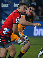 Bryn Hall passes as Pablo Matera chases during the 2019 Super Rugby final between the Crusaders and Jaguares at Orangetheory Stadium in Christchurch, New Zealand on Saturday, 6 July 2019. Photo: Dave Lintott / lintottphoto.co.nz
