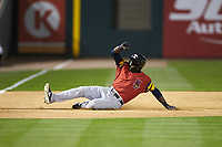Daz Cameron (10) of the Toledo Mud Hens slides into third base during the game against the Charlotte Knights at BB&T BallPark on April 23, 2019 in Charlotte, North Carolina. The Knights defeated the Mud Hens 11-9 in 10 innings. (Brian Westerholt/Four Seam Images)