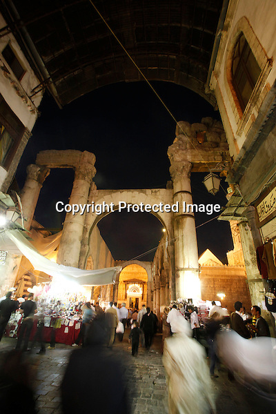 A Picture shows the souk with a corrugated metal roof, the ruins of a Roman temple, and at the end the entry to the Umayyad mosque, in Damascus, Syria, taken on November 05, 2010. (Salah Malkawi for The New York Times).