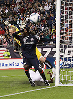 Toronto FC goalkeeper Stefan Frei (24) dives for the ball and New England Revolution midfielder Shalrie Joseph (21) reacts to the near miss at goal. The New England Revolution defeated Toronto FC, 4-1, at Gillette Stadium on April 10.2010