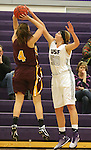 SIOUX FALLS, SD - JANUARY 30:  Sam Knecht #50 from the University of Sioux Falls blocks the shot of Allyson Harris #4 from Minnesota Duluth Friday night at the Stewart Center. (Photo by Dave Eggen/Inertia)