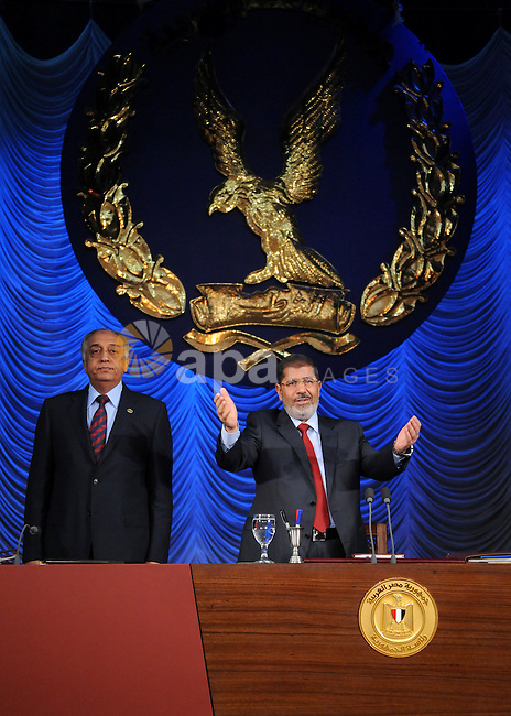 In this image released by the Egyptian Presidency, Egyptian President, Mohammed Morsi at a graduation ceremony at the Police Academy headquarters in Cairo, Egypt, July 14, 2012. The Police Academy was also the venue for the trial of ousted president Hosni Mubarak, who received a life sentence for failing to prevent the killing of protestors during the 2011 uprising. Photo/Ahmed Mourad, Egyptian Presidency