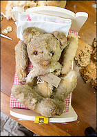 BNPS.co.uk (01202 558833)<br /> Pic: PhilYeomans/BNPS<br /> <br /> Even the most poorly bear's can be repaired and restored.<br /> <br /> Broken bears and deteriorating dolls from all over the world are being brought back to life by a UK team of dedicated doctors and nurses at one of the last remaining toy hospitals.<br /> <br /> The team at Alice's Bear Shop, a teddy bear and doll hospital in Lyme Regis, Dorset, perform all kinds of 'surgery' from simple restringing and re-stuffing to head re-attachments and complete skin grafts.<br /> <br /> Rikey Austin, 49, opened the hospital in January 2000 but also ran a shop and only repaired one or two toys a month.<br /> <br /> Now she has a four-month waiting list for patients and has had to close the shop to focus on the hospital side of the business.