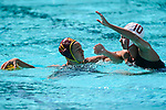 LOS ANGELES, CA - MAY 13: Brianna Daboub #11 of the University of Southern California looks for an open teammate over Kat Klass #10 of Stanford University during the Division I Women's Water Polo Championship held at the Uytengsu Aquatics Center on the USC campus on May 13, 2018 in Los Angeles, California. USC defeated Stanford 5-4. (Photo by Tim Nwachukwu/NCAA Photos via Getty Images)