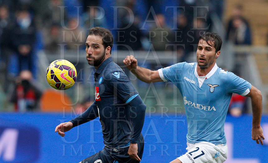 Calcio, Serie A: Lazio vs Napoli. Roma, stadio Olimpico, 18 gennaio 2015.<br /> Napoli&rsquo;s Gonzalo Higuain is chased by Lazio&rsquo;s Lorik Cana, right, during the Italian Serie A football match between Lazio and Napoli at Rome's Olympic stadium, 18 January 2015.<br /> UPDATE IMAGES PRESS/Riccardo De Luca