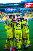 Phoenix players celebrate Gary Hooper's goal during the A-League football match between Wellington Phoenix and Melbourne Victory FC at Sky Stadium in Wellington, New Zealand on Sunday, 15 March 2020. Photo: Dave Lintott / lintottphoto.co.nz