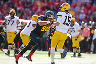College Park, MD - October 15, 2016: Maryland Terrapins defensive lineman Roman Braglio (90) pressures Minnesota Golden Gophers quarterback Conor Rhoda (15) during game between Minnesota and Maryland at  Capital One Field at Maryland Stadium in College Park, MD.  (Photo by Elliott Brown/Media Images International)
