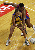 Vilimaina Davu pressures Pulse goalshoot Jamilah Gupwell during the ANZ Netball Championship match between the Central Pulse and Northern Mystics, TSB Bank Arena, Wellington, New Zealand on Monday, 4 May 2009. Photo: Dave Lintott / lintottphoto.co.nz
