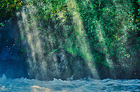 Sun streaking through mist on The Grass River at Pisew Falls<br />