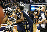 Nevada's D.J. Fenner, left, and Eliljah Foster celebrate their 65-63 victory over UNLV in Reno, Nev., on Saturday, Jan. 23, 2016. Cathleen Allison/Las Vegas Review-Journal