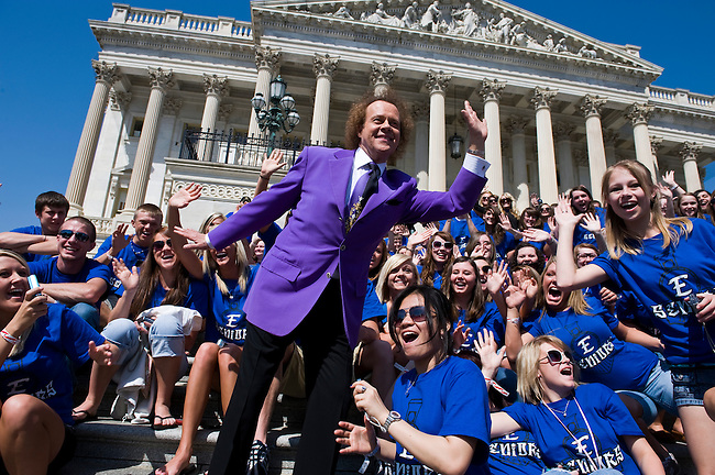 Fitness celebrity Richard Simmons interrupts Congressman Ben Chandler's speech to the senior class of Estill County High School, located in Irvine, Ky., on the House steps of the Capitol on April 22, 2010. Simmons was at the Capitol for a news conference on the passage of the Fit Kids Bill.