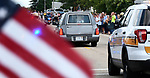 The procession continues to the funeral home after pausing briefly at Waterloo City hall where hundreds of residents had gathered to pay respects to fallen ISP Trooper Nick Hopkins. Dozens of police departments joined in the procession from St. Louis to Waterloo for slain Illinois State Police Trooper Nick Hopkins on Monday August 26, 2019. <br /> Photo by Tim Vizer