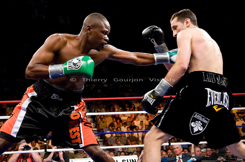 Uncasville, CT - June 7th, 2008: Vernon Forrest on the attack against Sergio Mora (black trunk) during their WBC Super Welterweight Championship fight at the Mohegan Sun Casino. Mora upset Forrest by taking his belt away with a split decision. Photo by Thierry Gourjon.